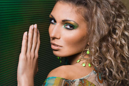 Sexy fashionable woman on green background photo