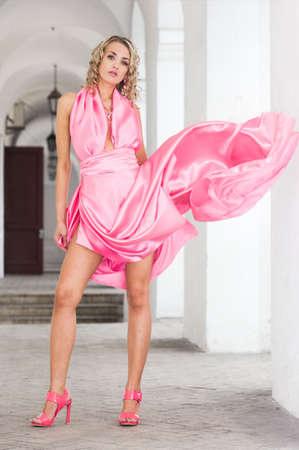 beautiful fashionable woman in pink dress Stock Photo - 6038901