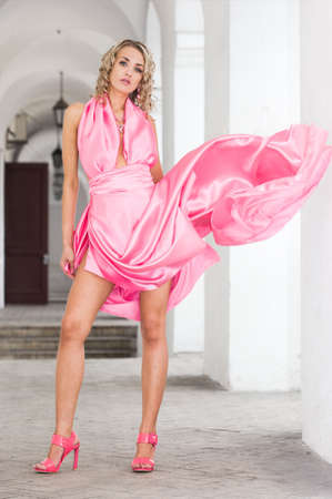 beautiful fashionable woman in pink dress Stock Photo - 6038901