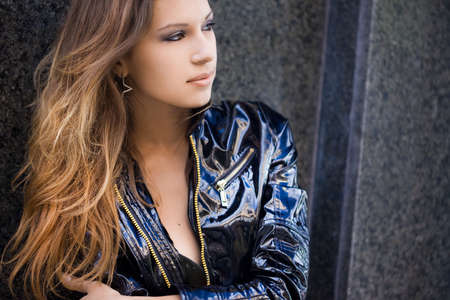 Beautiful woman in a leather jacket photo