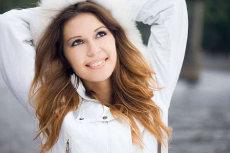 Happy woman in a jacket with fur photo