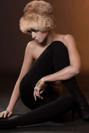 Woman in a fur hat photo
