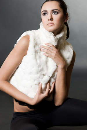 Woman in a fur waistcoat photo