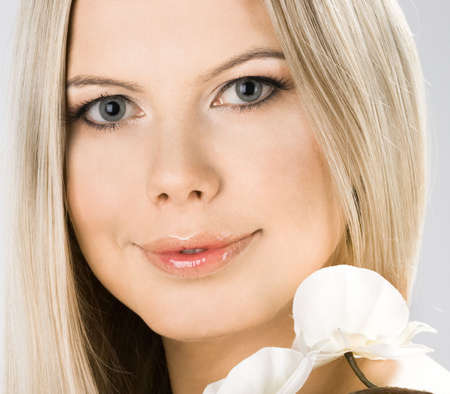 portrait of pretty woman with white orchids  photo