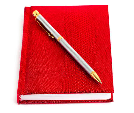 red notebook with silver pen Stock Photo - 7422459