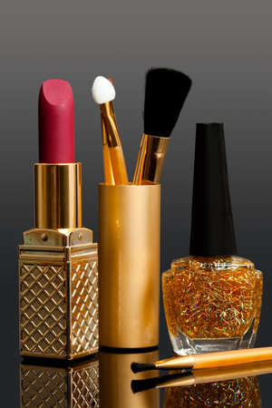 enamel: lipstick; enamel and cosmetic brushes Stock Photo