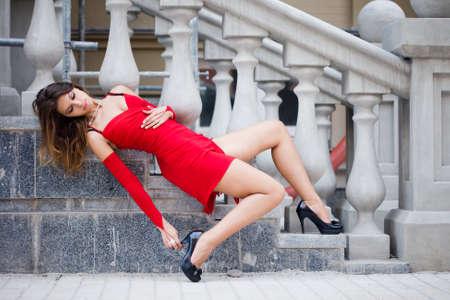 Beautiful woman near the stairs photo