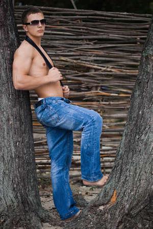 young bodybuilder man in street photo