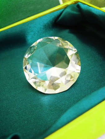 Beautiful diamond crystal on green box  Stock Photo - 7422500