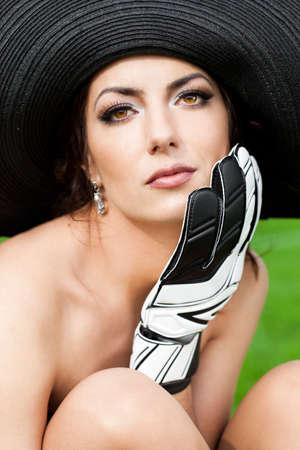 Elegant woman with Football Goalkeeper Glove photo