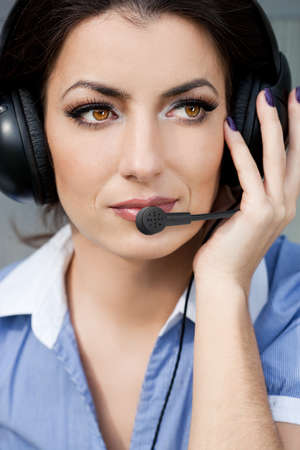 commentator: girl commentator with headset on the tribune