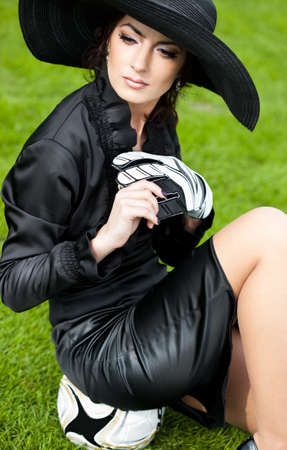 Elegant woman with Football ball photo