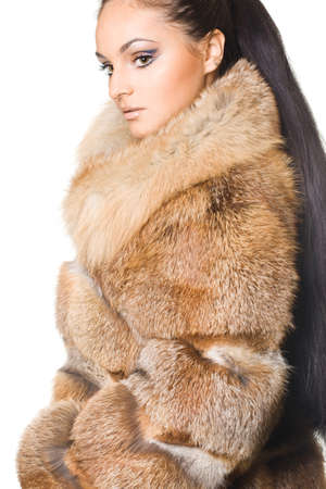 beautiful woman in a fur coat photo