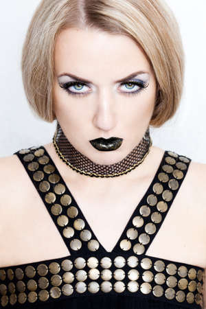 beautiful fashionable woman with art visage photo