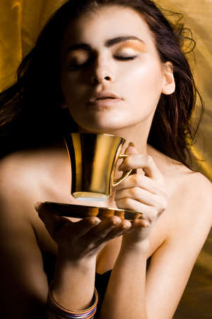 Beautiful woman with cup of coffee photo