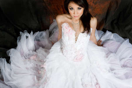 Bride in beautiful white dress photo