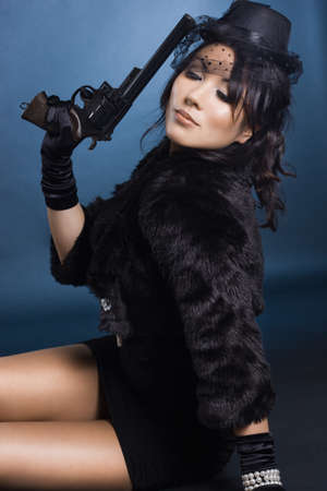 elegant lady with a pistol in hands photo