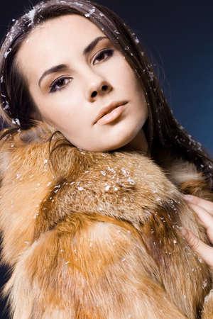 beautiful woman in a fur coat Stock Photo - 7487807
