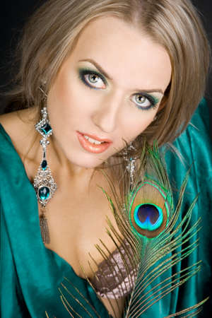fashionable woman with peacock feather photo