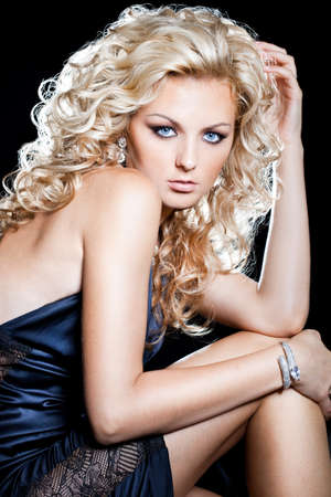 beautiful fashionable woman on black background photo