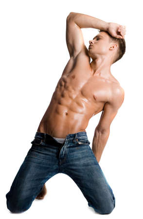 boy muscles: young bodybuilder man on white background