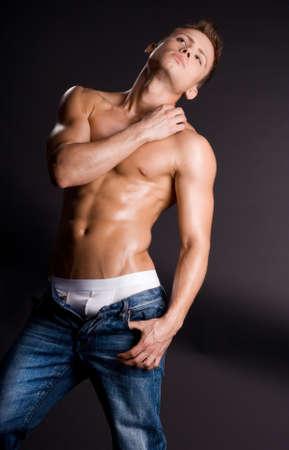 male model torso: young bodybuilder man on black background Stock Photo