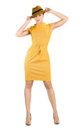 attractive businesswoman in yellow dress