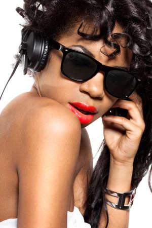 mulatto girl DJ listens music with headphones photo