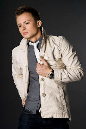 attractive businessman in beige jacket photo