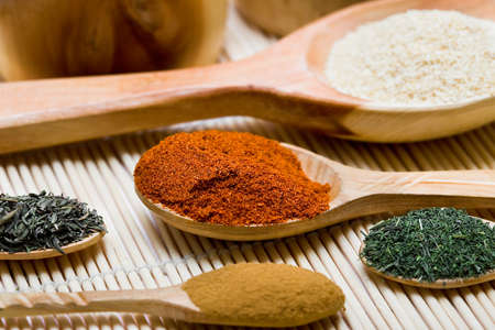 karri: many different spices in spoons  Stock Photo