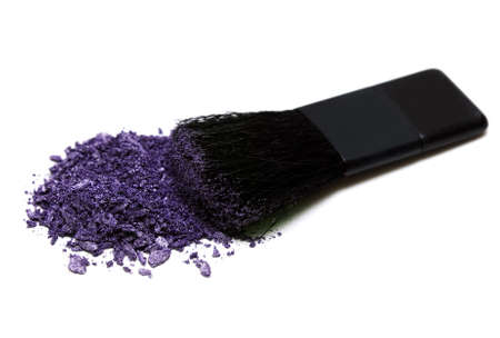 violet make-up eyeshadows and cosmetic brush  photo