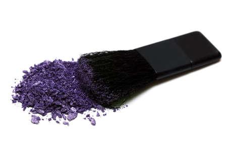 violet make-up eyeshadows and cosmetic brush  photo