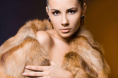 beautiful woman in a fur coat Stock Photo - 7953722