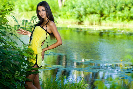 beautiful woman near the river photo
