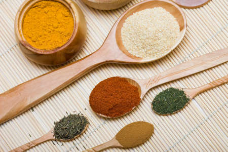 many different spices in spoons Stock Photo - 7964473