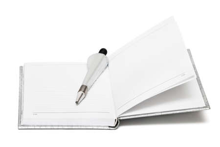 silver pen with opened notebook photo