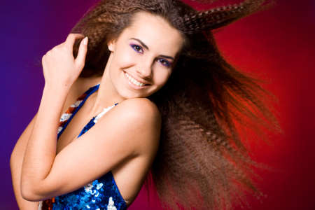 American woman in colored background Stock Photo - 7953806