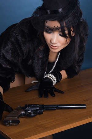 elegant lady with a pistol in hands Stock Photo - 8067831