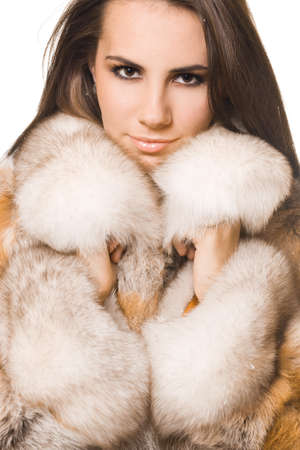 beautiful woman in a fur coat Stock Photo - 8068070