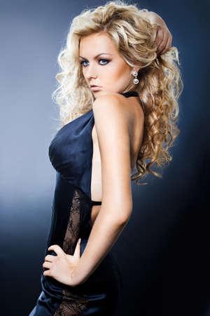 beautiful fashionable woman on blue background photo