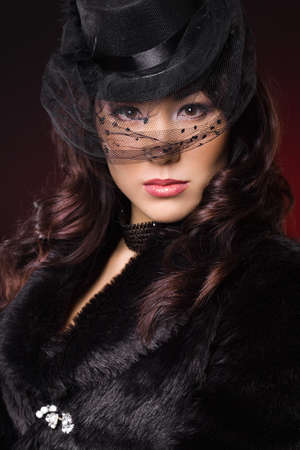 elegant fashionable woman in a hat photo