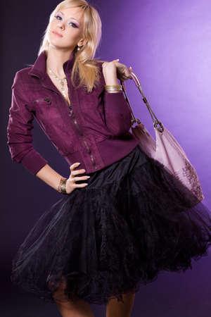 beautiful fashionable woman with handbag