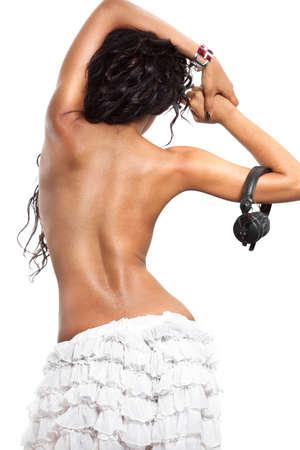 black girl nude: mulatto girl DJ listens music with headphones Stock Photo
