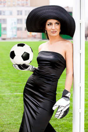 Elegant woman with Football ball photo