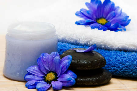 Cream, stones and towel with flowers photo
