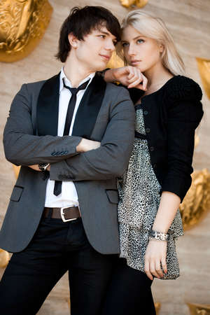 couple - girl and guy near the wall Stock Photo - 8189800