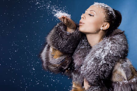 beautiful woman in a fur coat photo