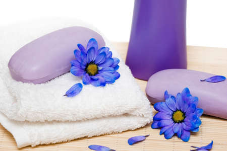 spa essentials, soap and towel with blue flowers Stock Photo