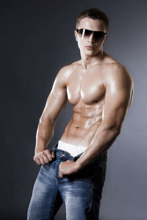 sportsman: young bodybuilder man on black background Stock Photo