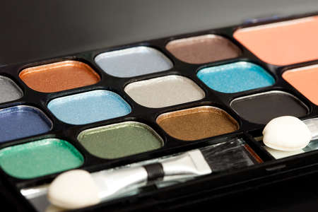 make-up eyeshadows and cosmetic brush photo